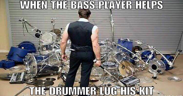 When the bass player helps the drummer lug his kit